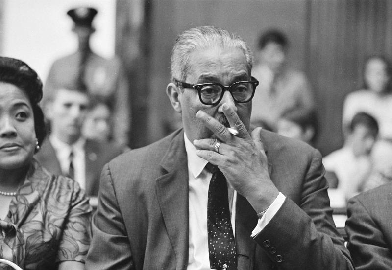 Thurgood Marshall, solicitor general of the U.S., has a smoke during a Senate hearing on his fitness to be appointed to the U.S. Supreme Court in Washington, July 19, 1967.