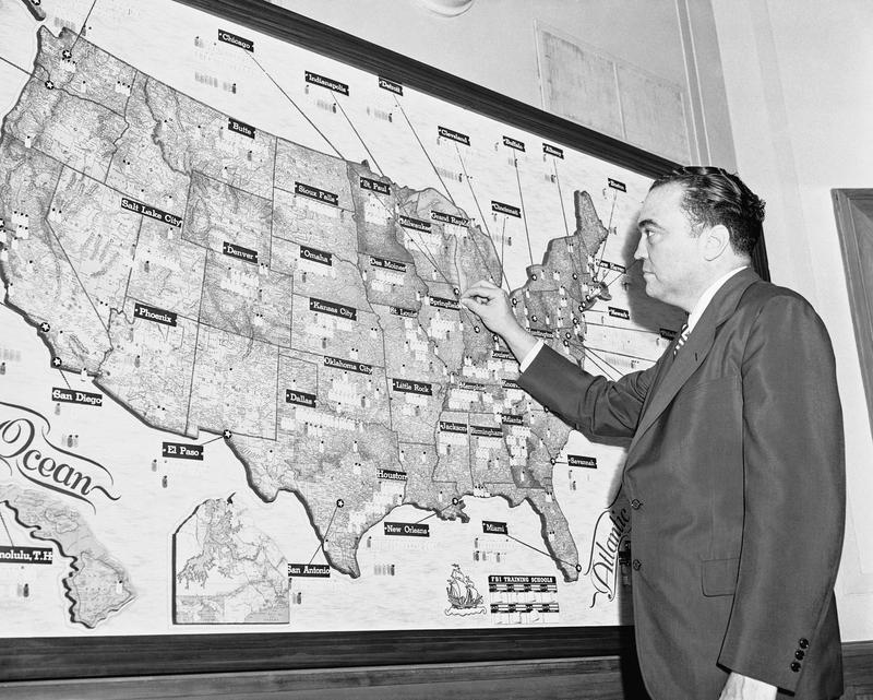 FBI director J. Edgar Hoover traces movements of his special agents in the U.S. and outlying possessions on May 3, 1954.