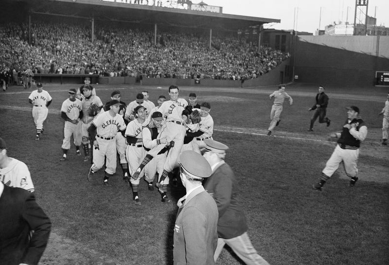 "Oct. 4, 1948"" Cleveland Indians pitcher Gene Bearden is carried off the field by enthusiastic teammates at the end of a game against Boston at Fenway Park in Boston."