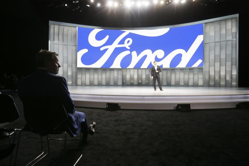 Bill Ford, executive chairman of Ford Motor Company, left, watches a presentation by Mark Fields, president and CEO, at the North American International Auto Show, Monday, Jan. 11, 2016, in Detroit.