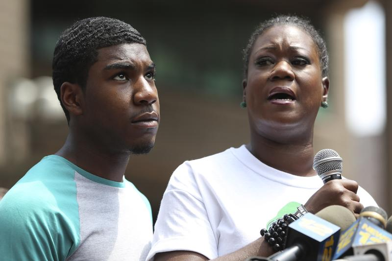 Sybrina Fulton, mother of Trayvon Martin, is joined by her son Jahvaris Fulton as she speaks to the crowd during a rally in New York.