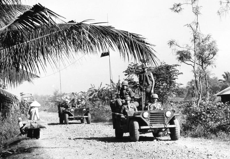 A U.S. military convoy moves into the Mekong Delta town of Rach Kein located some 20 miles southwest of Saigon, Vietnam, Jan. 5, 1967.