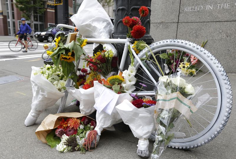 """Aug. 31, 2014: A white """"ghost bike"""" memorial for Sher Kung, a well-respected attorney who was part of the ACLU's legal team that challenged the military's """"Don't Ask, Don't Tell."""""""