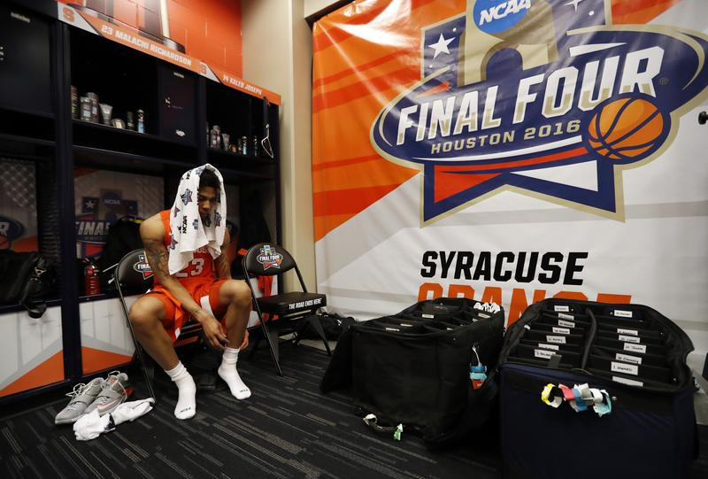Syracuse's Malachi Richardson (23) sits in the locker room after the NCAA Final Four tournament college basketball semifinal game against North Carolina, Saturday, April 2, 2016, in Houston.