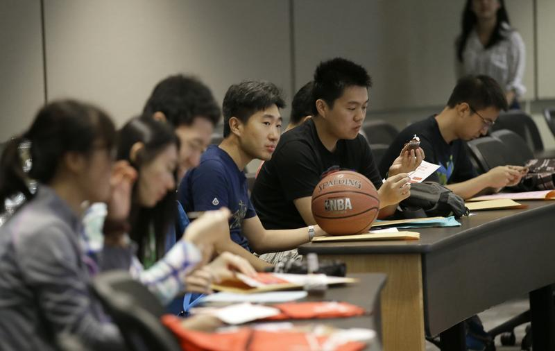 8/22/15: Weikang Nie, a finance graduate student from China, sits with his fellow Chinese students during a new student orientation at the University of Texas at Dallas.