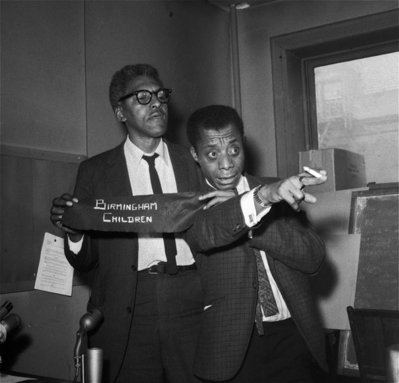 In this Sept. 18, 1963 file photo, author James Baldwin, right, and Bayard Rustin, deputy director of the March on Washington, discuss civil rights incidents in Alabama during a news conference in NY.