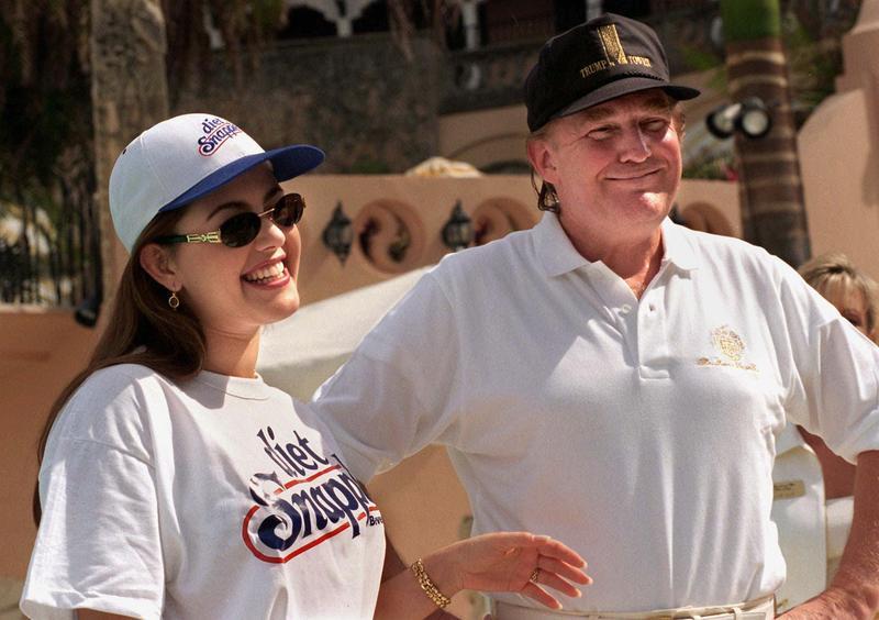 Miss Universe, Venezuelan Alicia Machado, left, appears with Donald Trump at his Mar-a-Lago club in Palm Beach, Fla. Saturday Feb. 15, 1997.