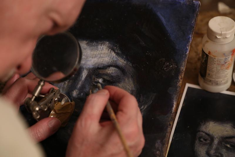 "Mark Landis at home and at work on a ""Picasso,"" from the documentary ""Art & Craft."