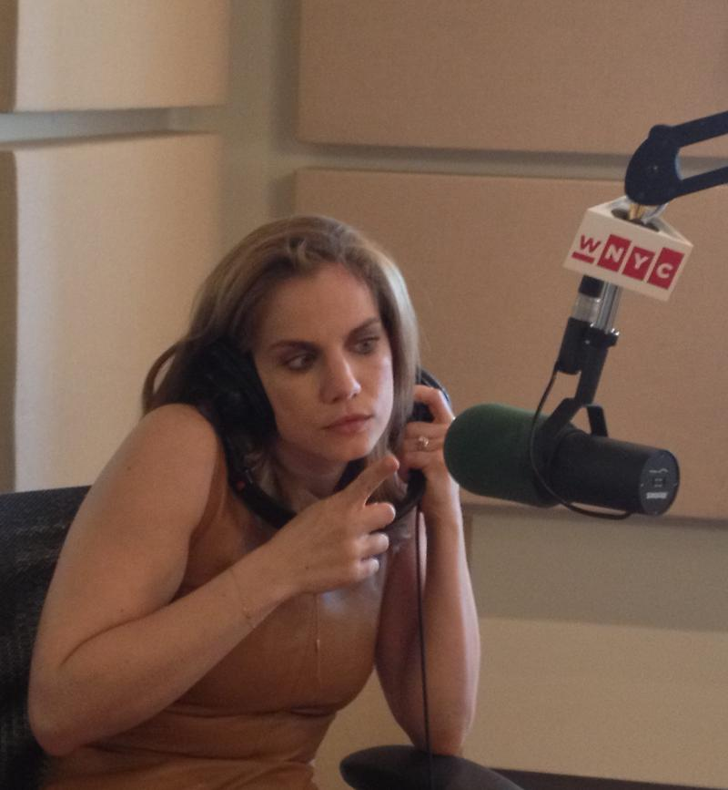 Anna Chlumsky at the mic in the WNYC studios