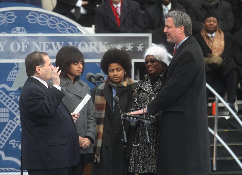 Public Advocate Bill de Blasio takes the oath of office administered by US Congressman Jerrold Nadler (L) acoompanied by his daughter Chiara (2nd-L), son Dante (C) and wife Chirlane on Jan. 1, 2010.