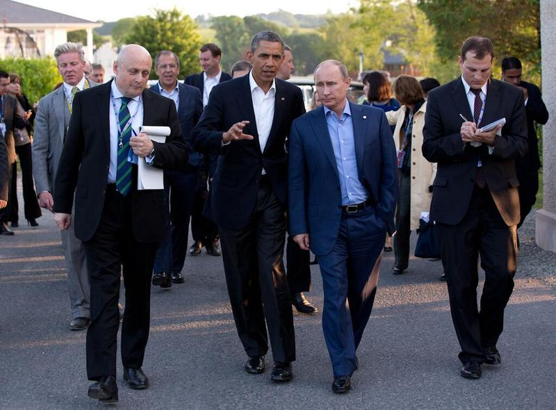 United States President Barack Obama and Russian President Vladimir Putin walk to the G8 Summit dinner following their bilateral meeting in Ireland on 17 June 2013.