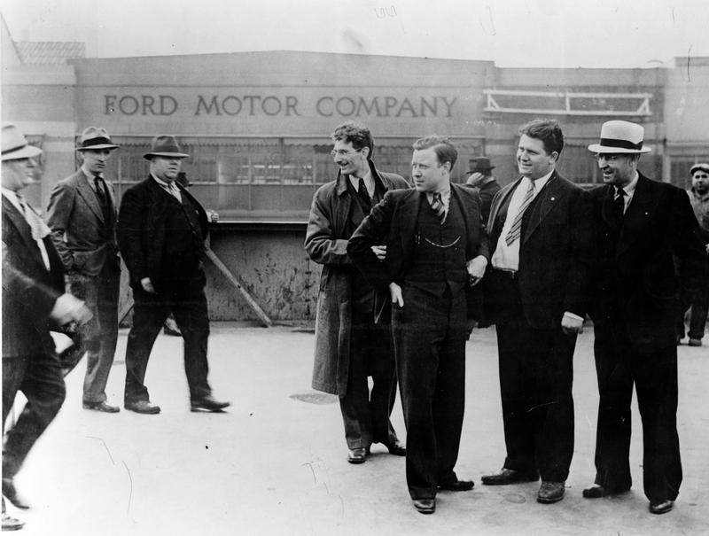 Moments before being beaten, UAW organizers including Walter Reuther (3rd from r.)  face off against Ford security guards at the River Rouge plant in Michigan, 1937.