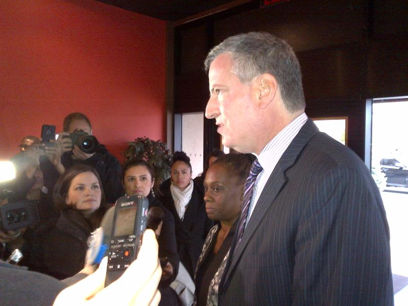 Mayor-elect de Blasio and his wife Chirlane McCray speak to reporters about Nelson Mandela at a service at the Christian Cultural Center in Brooklyn.