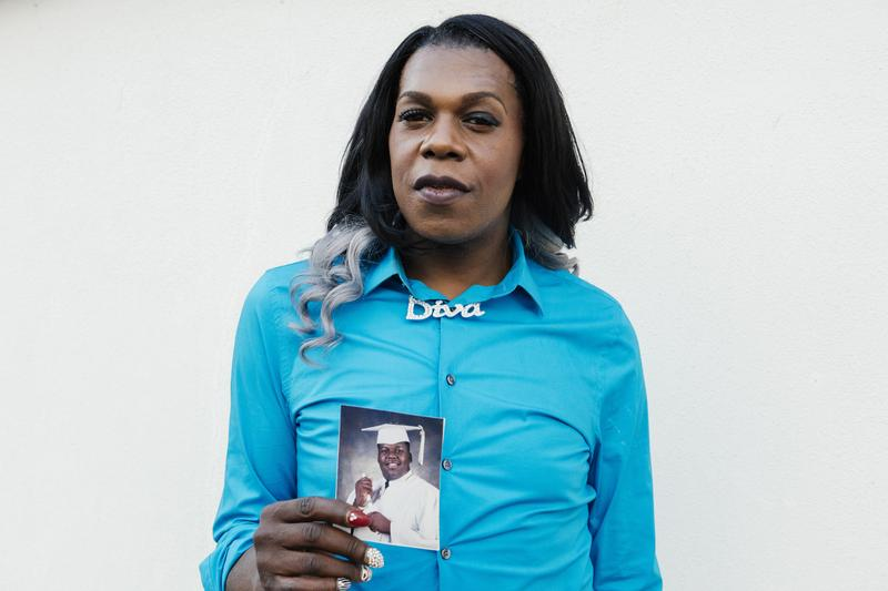Big Freedia, holding her graduation photo from Walter Cohen High School in 1996.
