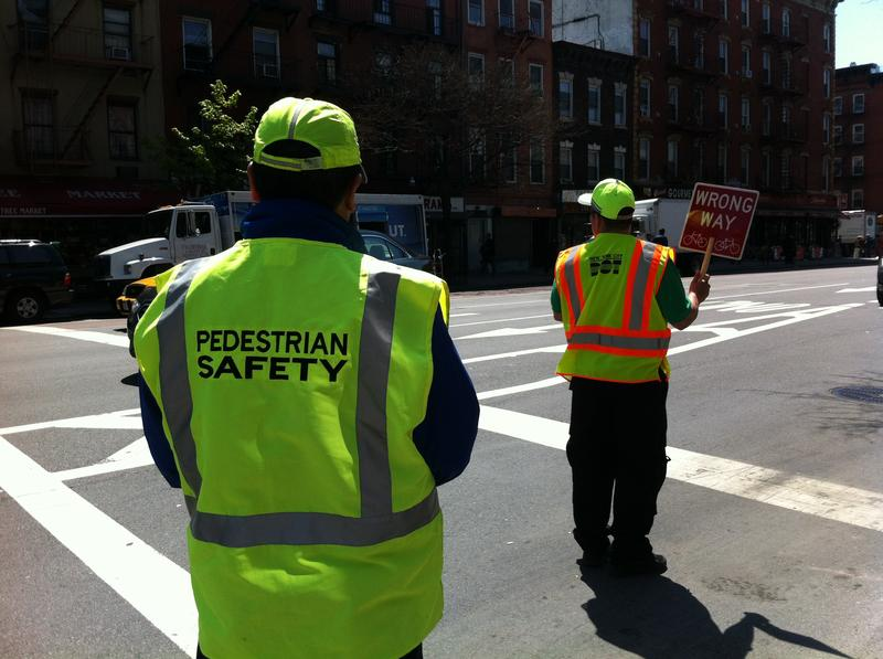 DOT employees train as street safety managers along First Avenue in the East Village on Friday.