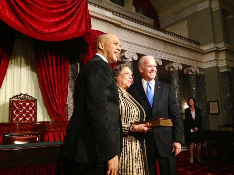 Cory Booker after getting sworn in as US Senator. His mother, Carolyn Booker, stands between him and Vice President Joe Biden.
