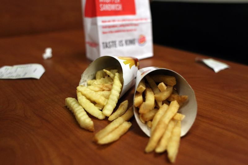 "Burger King ""Satisfries"" next to an order of regular french fries."