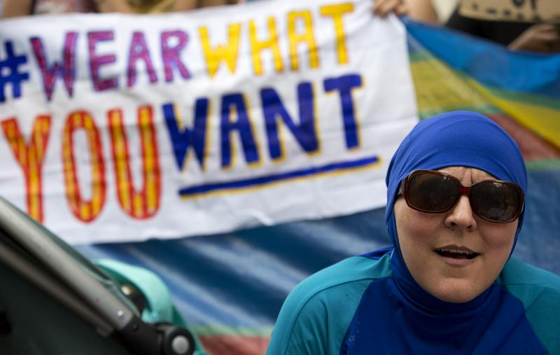 """A woman wearing a """"Burkini"""" protests outside the French Embassy in London on August 25, 2016, during a """"Wear what you want beach party"""" to demonstrate against the ban on Burkinis on French beaches."""