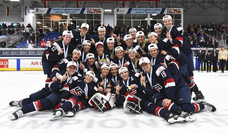 The United States team poses after overtime of the gold-medal game of the women's world hockey championships against Canada, Friday, April 7, 2017, in Plymouth, Mich.