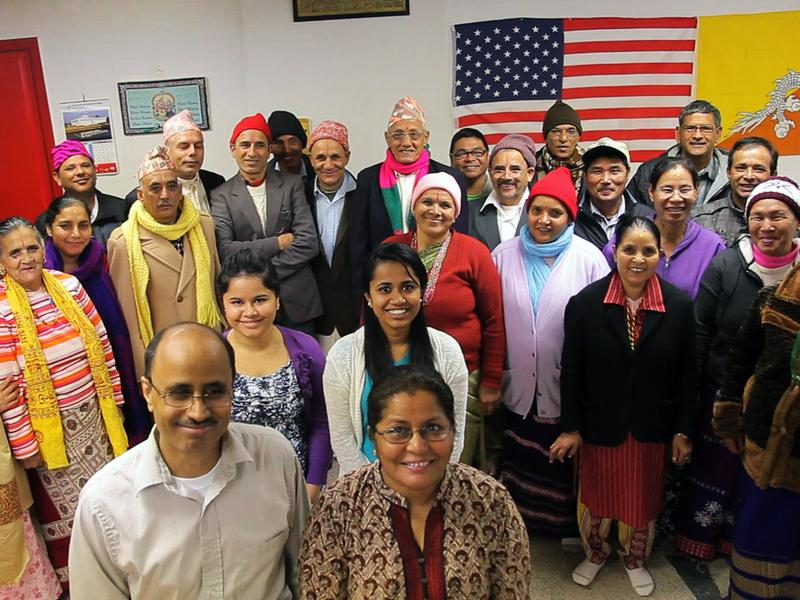 Former refugee Birendra Dhakal poses for a picture with his citizenship class in Clarkston, Georgia.