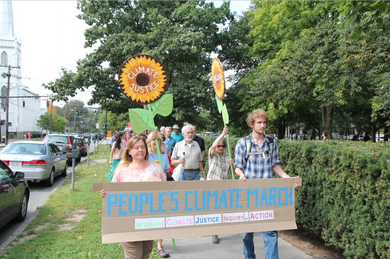 About 200 people demonstrate in the People's Climate March in Ithaca in September 2014.