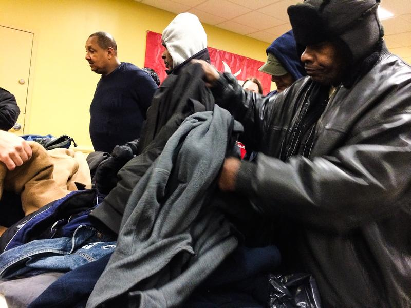 Raulo Jeffers (right), 55, at the annual coat drive at the New York City Rescue Mission in Chinatown on Christmas Day 2013.