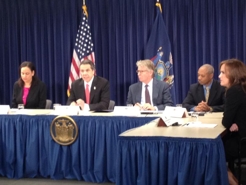 Gov. Andrew Cuomo details his proposed changes to state corruption statues alongside his counsel and district attorneys from Manhattan, the Bronx, and Nassau County.