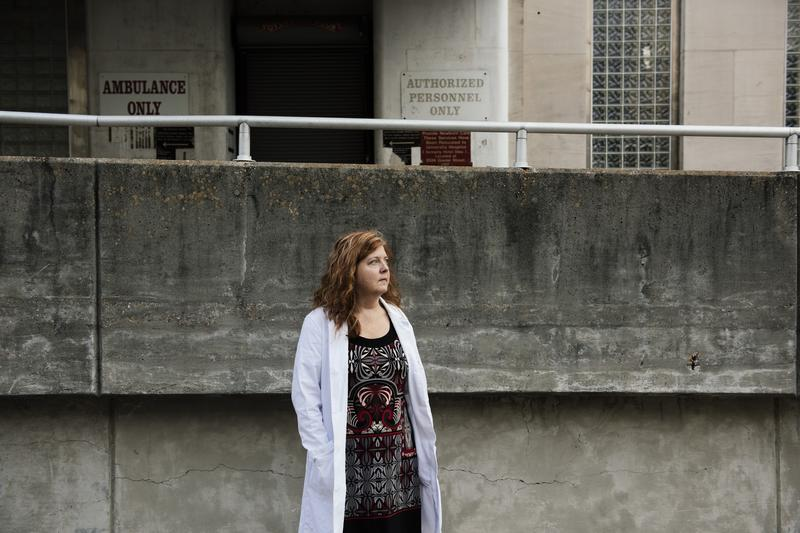 Dr. Kiersta Kurtz-Burke, standing in front of the emergency room ramp at Charity Hospital, where she was during Hurricane Katrina.