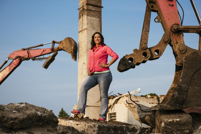 Simone Bruni, a.k.a. the Demo Diva, on a job site with her signature hot pink equipment.