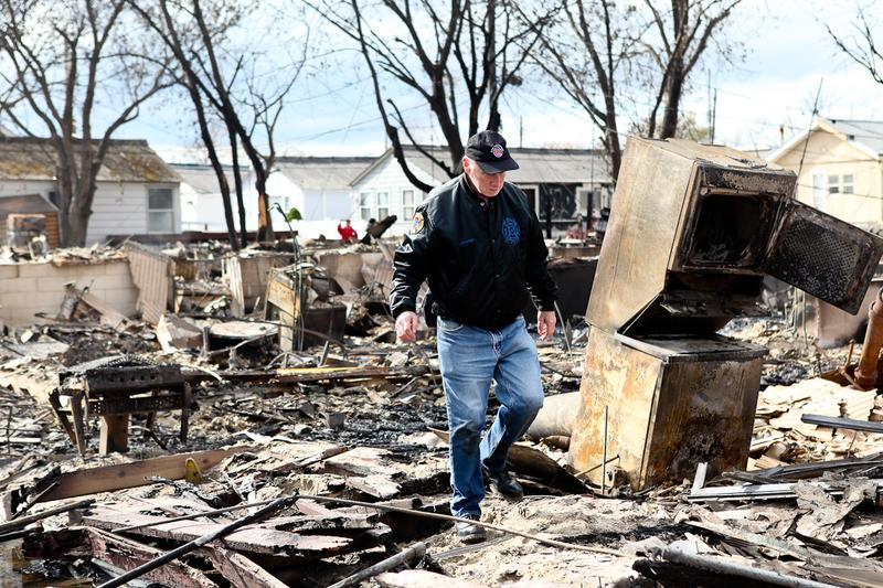Several days after Sandy burned down more than 100 homes in Breezy Point, residents continued to pick through the rubble for belongings.