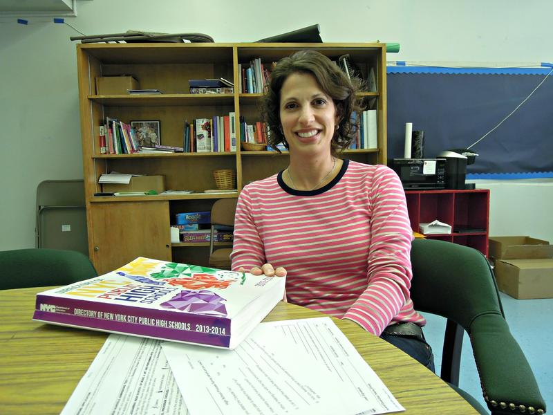 Erin Hill, a school counselor at The Computer School, has students turn in practice applications ahead of the December deadline.