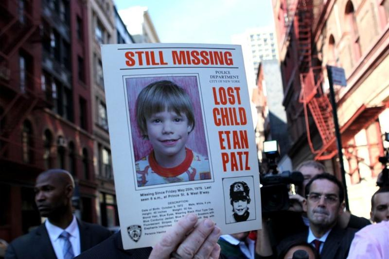 An NYPD spokesman holding the original missing persons sign for Etan Patz, who went missing in 1979.