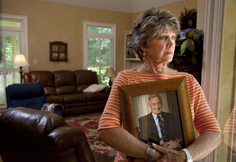 Cheryl Morgan, whose story is featured in Life and Death in Assisted Living, holds a photo of her late father.