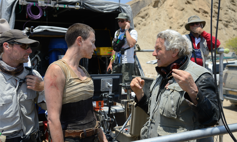 """George Miller with Charlize Theron on the set of """"Mad Max: Fury Road"""""""