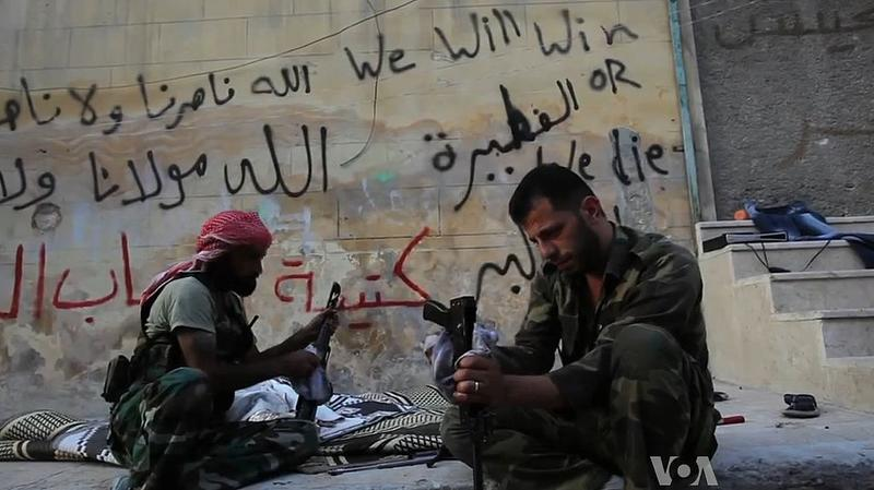 Free Syrian Army rebels cleaning their AK47s in Aleppo, Syria during the civil war. October 2012.