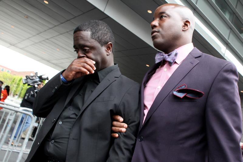 Francelot Graham (L), father of Ramarley Graham, who was shot by police officer Richard Haste, and the family's lawyer Royce Russell (R) after a judge threw out the indictment for technical reasons.