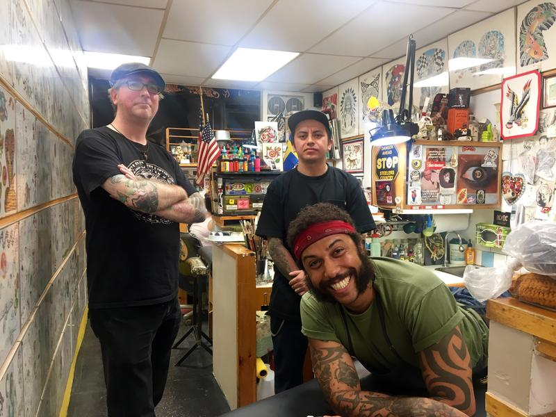 Tattoo artists at Fineline Tattoo, the oldest tattoo parlor in New York City.