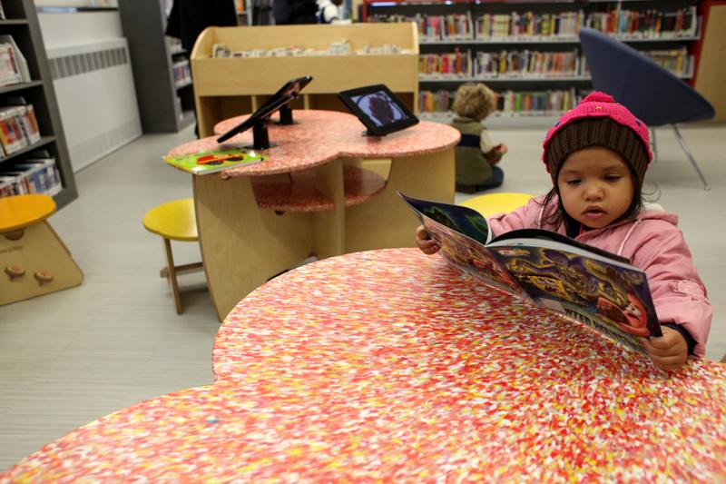 Gabriella Vajasa, 2, at opening day of the Coney Island library branch on Mermaid Avenue.