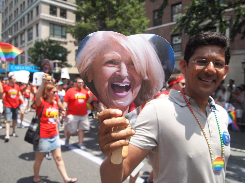 A parade goer holds up the image of Edie Windsor