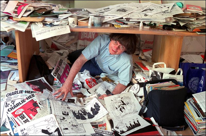 Cabu, a comic book artist who worked for Charlie Hebdo and was killed in last year's attacks, at his office in 2002.