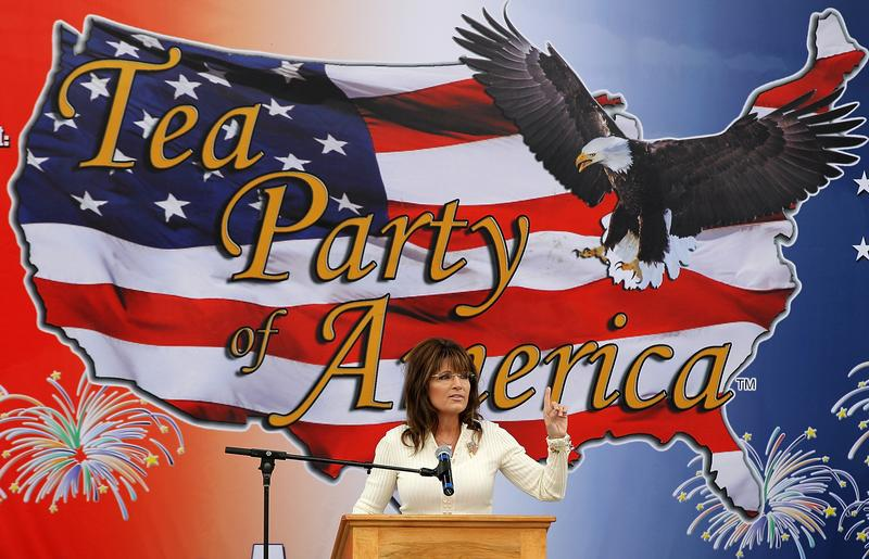 Former Alaska governor Sarah Palin speaks during the Tea Party of America's 'Restoring America' event at the Indianola Balloon Festival Grounds on September 3, 2011 in Indianola, Iowa.