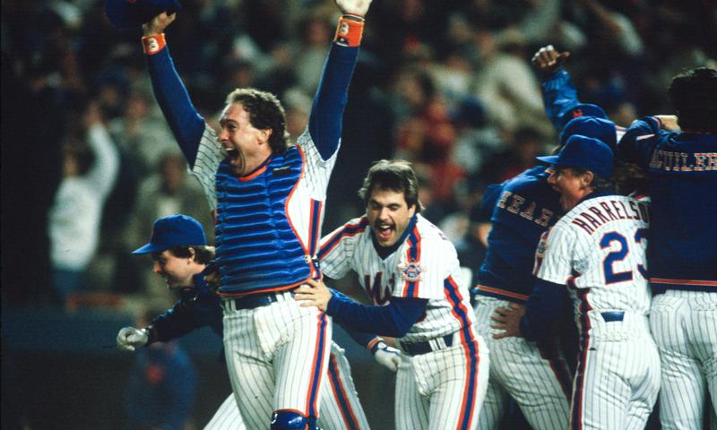 Gary Carter #8 and Wally Backman #6 of New York Mets celebrate after winning the 1986 Major League Baseball World Series