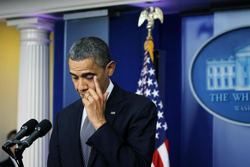 President Obama wipes tears while making a statement on the Sandy Hook shooting in 2012.