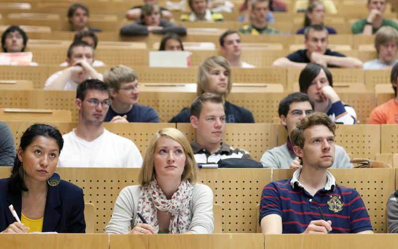 Students from a technical university sitting in a lecture hall.