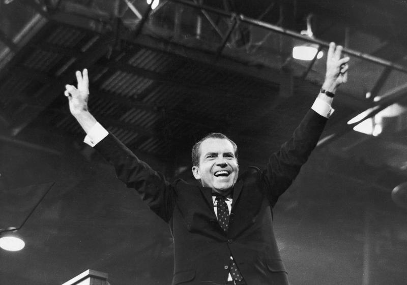August 1968: Richard Nixon gives the 'V' for victory sign after receiving the presidential nomination at the Republican National Convention, Miami, Florida.