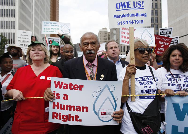 Congressman John Conyers, Jr., (D-Mich.) joins demonstrators protesting against the Detroit Water and Sewer Department July 18, 2014 in Detroit, Michigan.