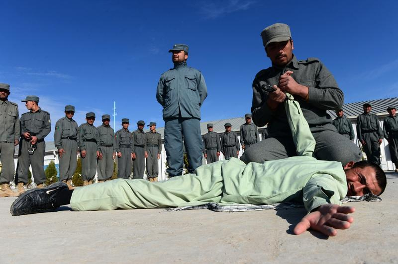 Afghan policemen perform a drill during exercises at a police training centre in Herat on January 27, 2015.