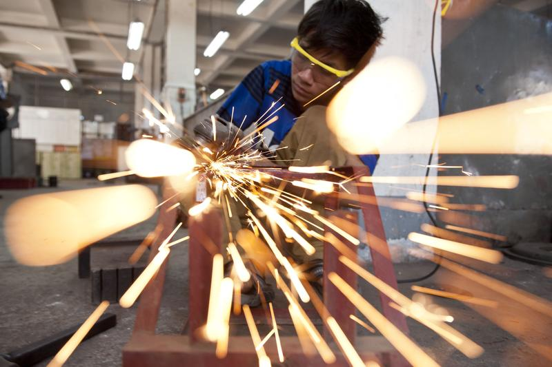 An employee works in a factory in an industrial zone in Yangon, Mayanmar on February 13, 2014.