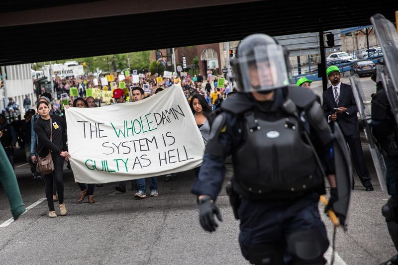Protesters march through the streets in support of Maryland state attorney Marilyn Mosby's announcement that charges would be filed against Baltimore police officers in the death of Freddie Gray.