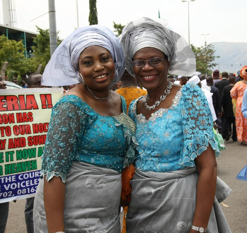 Two women attend the swearing in of Nigeria's new president Muhammadu Buhari on May 29, 2015 in Abuja, Nigeria.